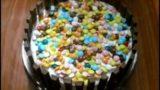 Decorazione torta bambini con M&M e nutella facilissima